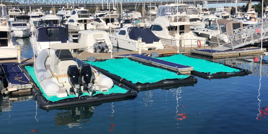 Three new SeaPens next to each other in a marina