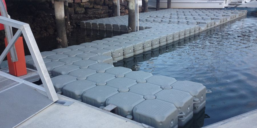 Custom FloatBricks dock with floating walkway ready to get 5 Boats on it
