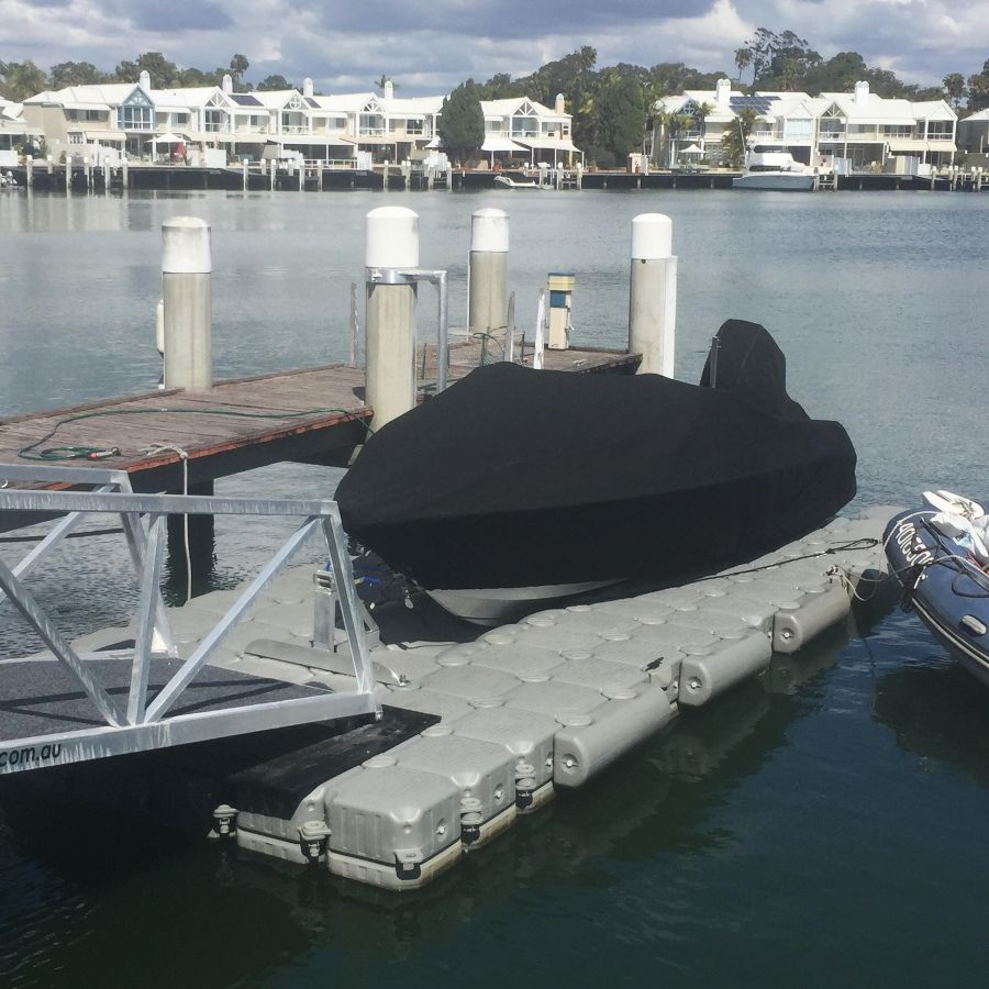 Newly installed FloatBricks boat dock with gangway for easy access
