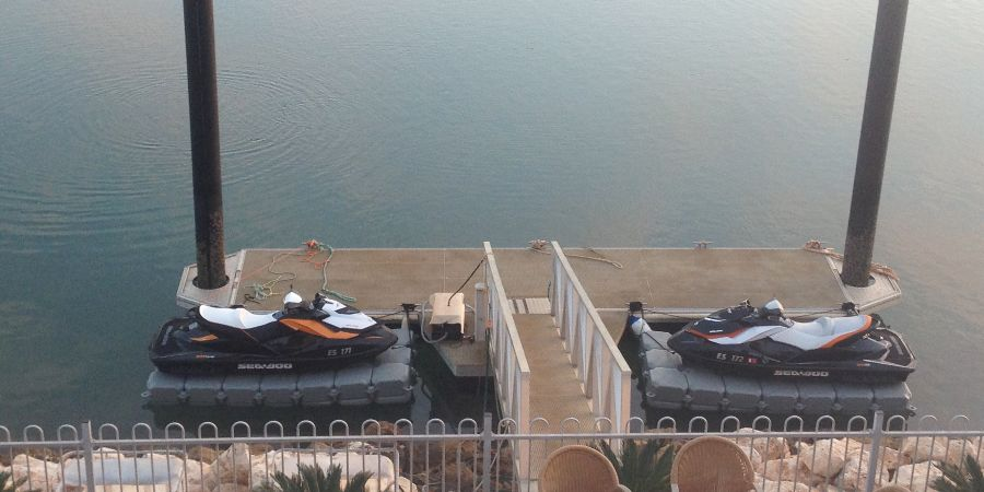 Two FloatBricks V-350 jet ski docks installed at the back of a private jetty. Ideal solution for limited docking space